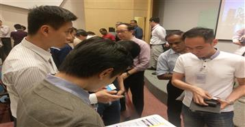 DNV GL meeting prospective customers at the SCA Singtel event